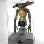 Gremlins movie prop and Clamp Logo acrylic display case