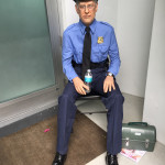 wax museum style figures of security guard