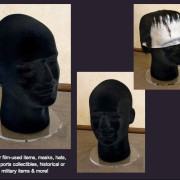 styrofoam male head in black with round acrylic base