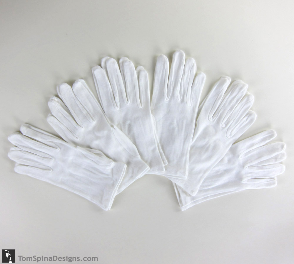 archival museum style white cotton gloves