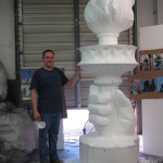 styrofoam artist carving statue of liberty torch