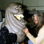 sculptor of lifesized slimer movie prop statue