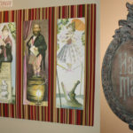 Haunted Mansion replica plaque and a custom display for prints of the stretching portraits