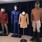Costumes displayed together, from Star Wars, The Tick, Star Trek and The Rocketeer.