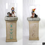 Pinocchio and Figaro statues prop