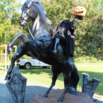 headless horseman and horse statue with tombstones