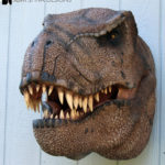 Scaled T-Rex Head Prop Bust on wall