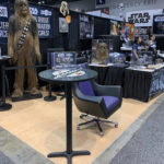 life-sized chewbacca statue and emperor throne desk chair