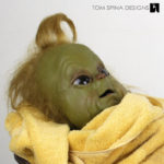 custom display and restoration of baby grinch puppet movie prop